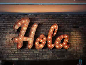 'Hola' sign on the wall.