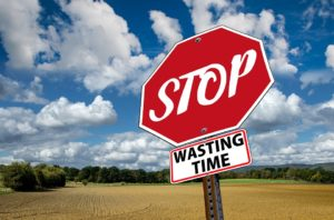 "a sign that says ""stop wasting time""."