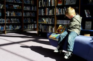A boy in a library.