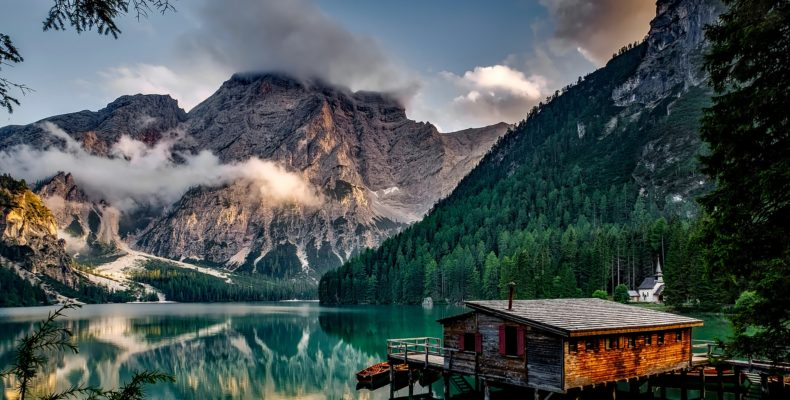 Beautiful forest, lake and a cabin, make moving to the country very inviting.