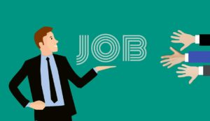 An illustrated man holding a job sign