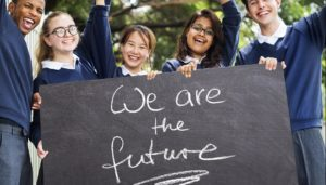 """we are the future"" sign, held by the school children"