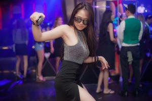 Woman in the nightclub.