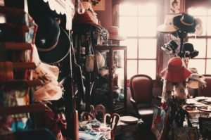 A room full of hats and clutter