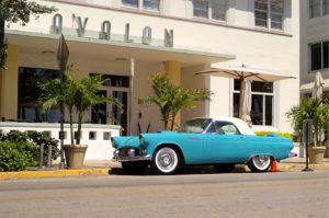 blue vintage car in the street