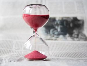 an hourglass because organizing your time is important when you need to move in a week