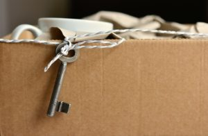 brown packing box with an old key attached