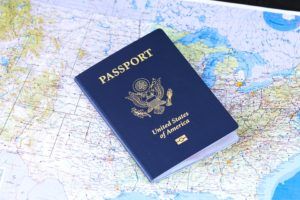 a world map and a passport on it because you need it when moving from Florida to Arizona
