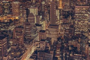 a birdview of NYC by night which makes moving to NYC so appealing