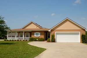 A house with a porch, lawn, and garage next to it as a perfect choice when you decide to live in Florida.