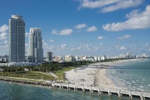 A view of one beach in Miami that can help you decide where to live in Florida.