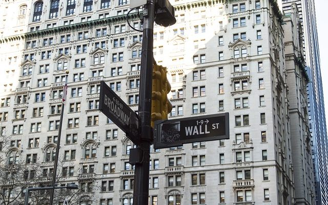 A sign showing Wall Street, a place where you can live in the Financial District