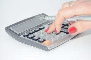 A woman using a calculator.