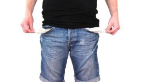 A man pulling out his empty pockets.