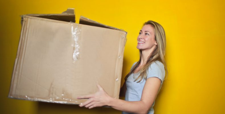 Moving by yourself - woman holding a box