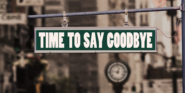 """Sign on a building """"time to say goodbye"""""""