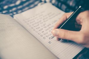 Creating a checklist for organizing your new home.