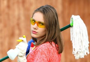 A girl with cleaning products.