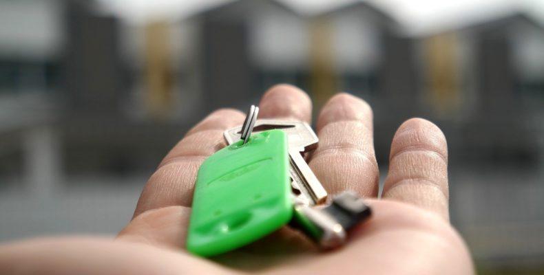 a hand with a house key