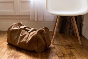 Travel bag sitting on the floor