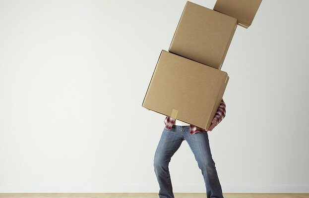 Man Carrying Moving Boxes - What not to do when movers pack