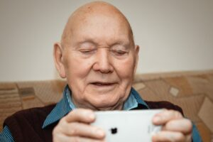 senior man looking at the mobile phone