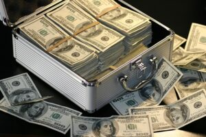 A lot of dollar banknotes you will need when expanding your Miami business to LA.