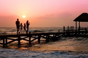 A family on the dock at sunset