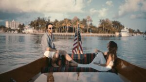 man and woman on a boat with american flag