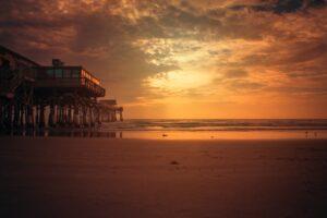 a sunset on a beach in lantana