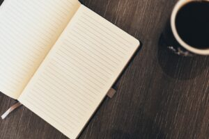 A notebook to write down the plan for your moving to Daytona Beach.