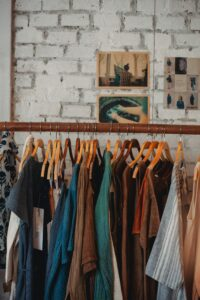Some boutique clothing on a rack