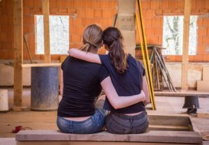 2 girls remodeling an old house.