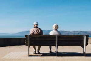 seniors sitting on a bench