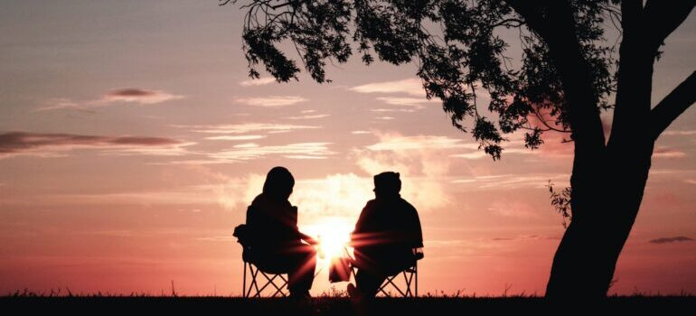 two seniors enjoying the sunset view in the beautiful places to move to after retirement