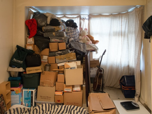 A pile of unorganized boxes and belongings when moving from Colorado to the Sunshine state.