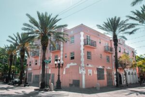 Pink building surrounded by palm trees in Little Havana, a top-notch Miami location for opening a new office