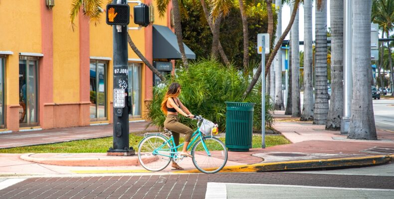 Woman riding a bike waiting at the traffic light in Miami