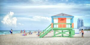 A beach in South Florida as one of the reasons why Canadian seniors are moving to Florida.