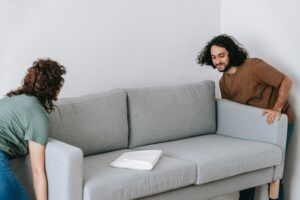 Couple moving a couch and moving in together