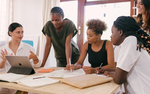 Women in a meeting expanding a tech company