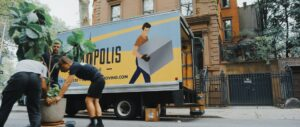 movers packing boxes in moving truck